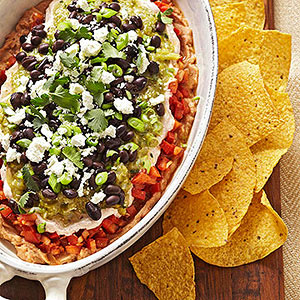 red and green layered bean dip